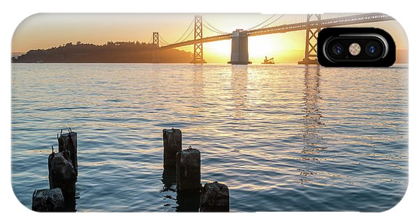 Six Pillars Sticking Out The Water With Bay Bridge In The Backgr IPhone Case