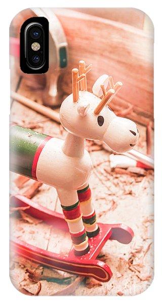 Small Xmas Reindeer On Wood Shavings In Workshop IPhone Case