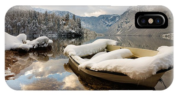 Snow Covered Boat On Lake Bohinj In Winter IPhone Case