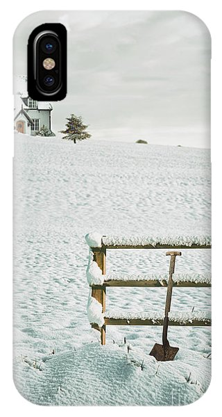 Treeline iPhone Case - Spade Leaning Against Fence In The Snow by Amanda Elwell