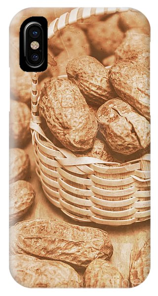 Indoors iPhone Case - Still Life Peanuts In Small Wicker Basket On Table by Jorgo Photography - Wall Art Gallery