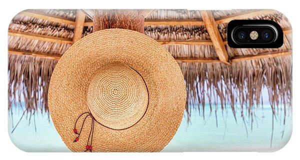837f0d04a1f Straw Umbrella iPhone Case - Sun Hat Hanging On Sunshade Umbrella On  Tropical Beach. Maldives