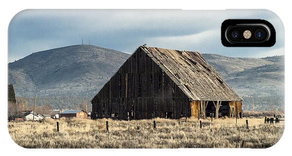 IPhone Case featuring the photograph The Old Barn At The Edge Of Town by The Couso Collection