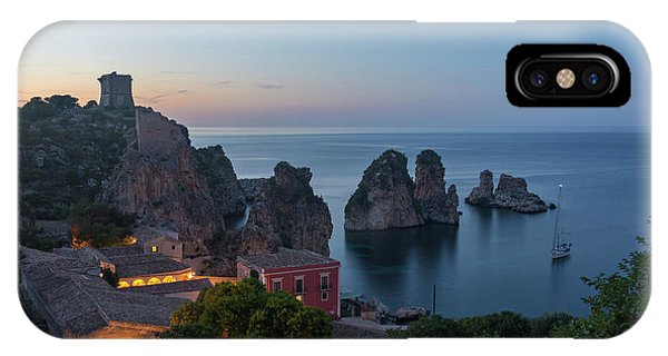 IPhone Case featuring the photograph Tonnara And Faraglioni Rocks In Scopello At Dusk by IPics Photography
