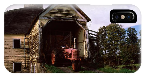 New England Barn iPhone Case - Tractor Parked Inside Of A Round Barn by Panoramic Images