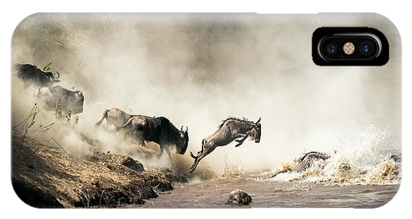 Wildlife iPhone Case - Wildebeest Leaping In Mid-air Over Mara River by Susan Schmitz