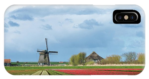 IPhone Case featuring the photograph Windmill With Tulip Flower Fields In The Countryside by IPics Photography