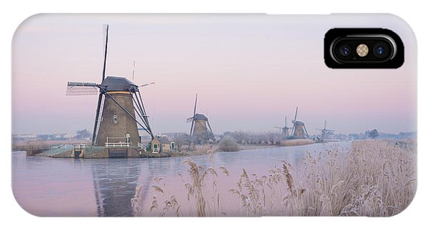 IPhone Case featuring the photograph Windmills In The Netherlands In The Soft Sunrise Light In Winter by IPics Photography