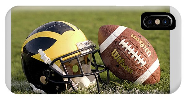 Wolverine Helmet With Football On The Field IPhone Case