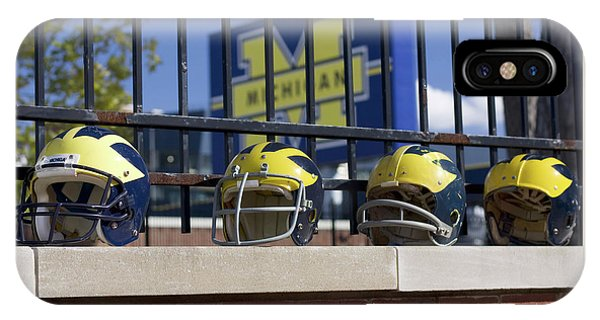 Wolverine Helmets Of Different Eras On Stadium Wall IPhone Case