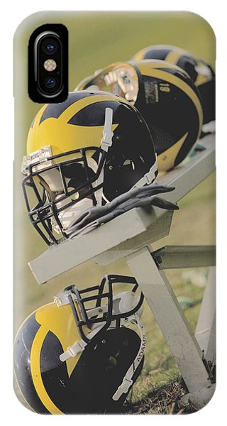 Wolverine Helmets On A Football Bench IPhone Case