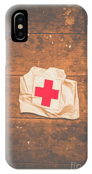 Left iPhone Case - Ww2 Nurse Cap Lying On Wooden Floor by Jorgo Photography - Wall Art Gallery
