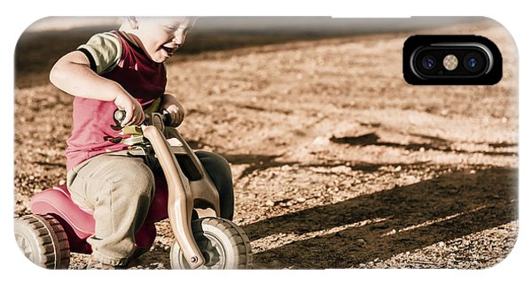 Stop Action iPhone Case - Young Boy Breaking At Fast Pace On Toy Bike by Jorgo Photography - Wall Art Gallery