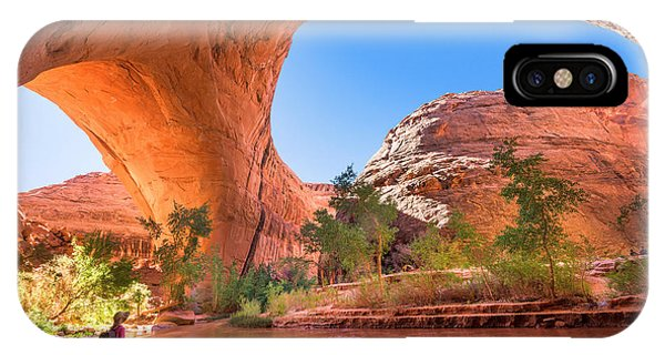Red Rock iPhone X Case - A Hiker At Jacob Hamblin Arch In Coyote by Kojihirano
