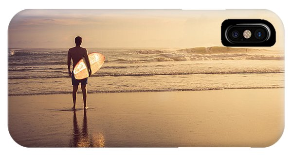 Surfboard iPhone Case - A Man Is Standing With A Surf In His by Mariia Smeshkova