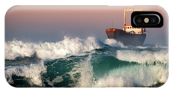 IPhone Case featuring the photograph Abandoned Ship And The Stormy Waves by Michalakis Ppalis