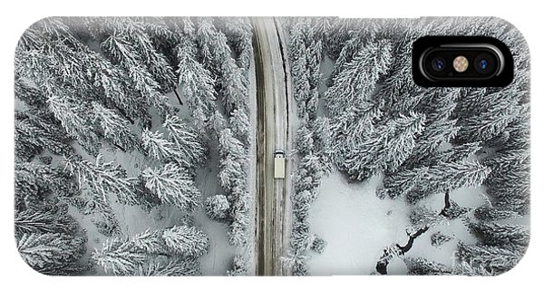 Snowy Road iPhone Case - Aerial View Of A Snowy Forest With High by Omphoto