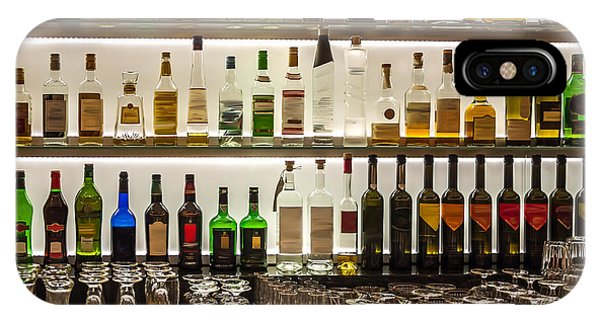 Bar iPhone Case - Backlit Bottles And Glassware Behind A by Ken Felepchuk