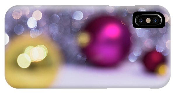 IPhone Case featuring the photograph Blurry Christmas Background With Christmas Balls And Bokeh by Cristina Stefan