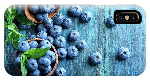Blue Berry iPhone Case - Bowl Of Fresh Blueberries On Blue Rustic Wooden Table From Above by Jelena Jovanovic