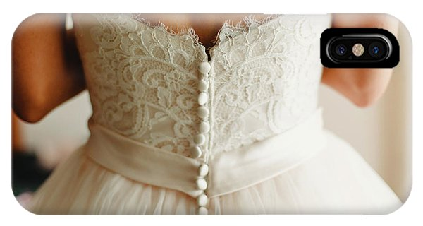 Bride Getting Ready, They Help Her By Buttoning The Buttons On The Back Of Her Dress. IPhone Case