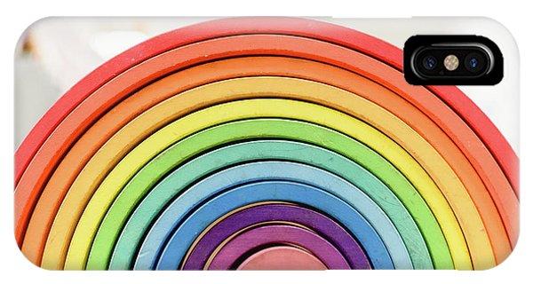 Colorful Waldorf Wooden Rainbow In A Montessori Teaching Pedagogy Classroom. IPhone Case