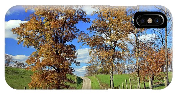 IPhone Case featuring the photograph Country Road Through Fall Trees by Angela Murdock