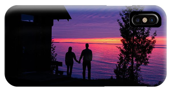 IPhone Case featuring the photograph Couple At Sunset by Paul Schultz
