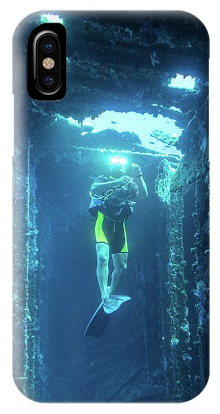 IPhone Case featuring the photograph Diver In The Patris Shipwreck by Milan Ljubisavljevic