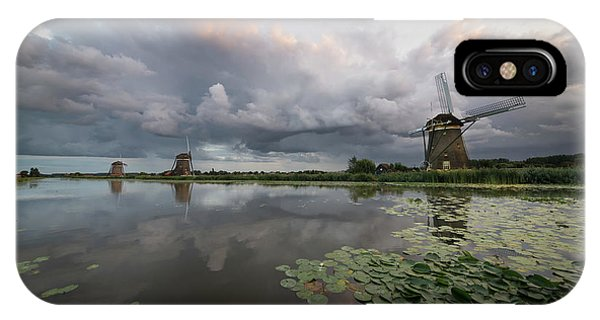 IPhone Case featuring the photograph Dramatic Sky Over Three Windmills In Holland by IPics Photography