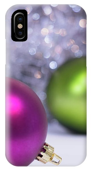 IPhone Case featuring the photograph Festive Scene For Christmas With Xmas Balls And Lights In Backgr by Cristina Stefan