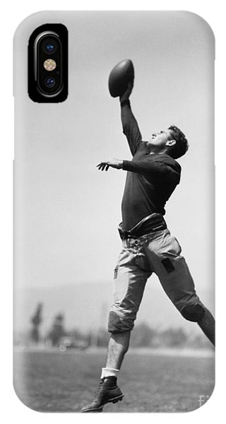 Physical iPhone Case - Football Player Catching Ball by Everett Collection
