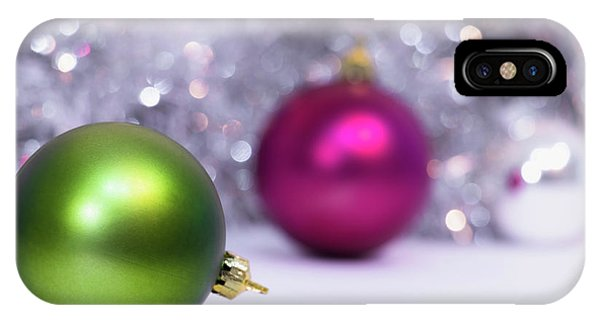 IPhone Case featuring the photograph Green And Fuchsia Christmas Balls And Lights In Background. Wint by Cristina Stefan