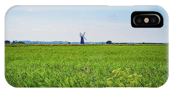 IPhone Case featuring the photograph Green Grass Field With Windmill On Horizon by Scott Lyons
