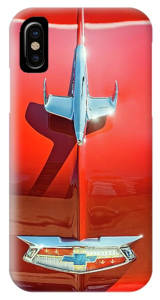 Vehicles iPhone Case - Hood Ornament On A Red 55 Chevy by Scott Norris