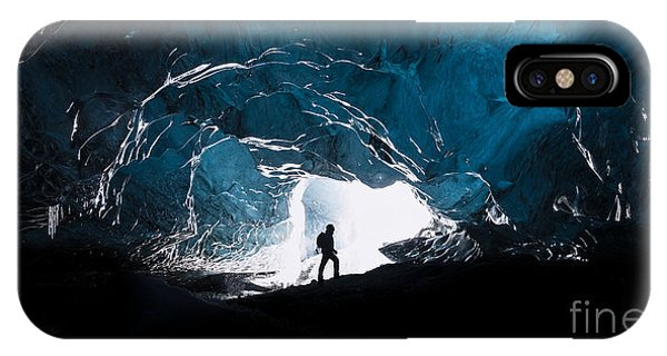 Man Cave iPhone Case - Man Exploring An Amazing Glacial Cave by J. Helgason