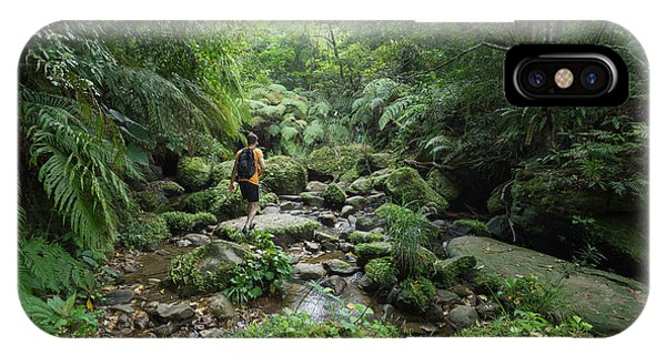 Lush iPhone Case - Man Exploring Dense Tropical Jungle And by Sam Spicer