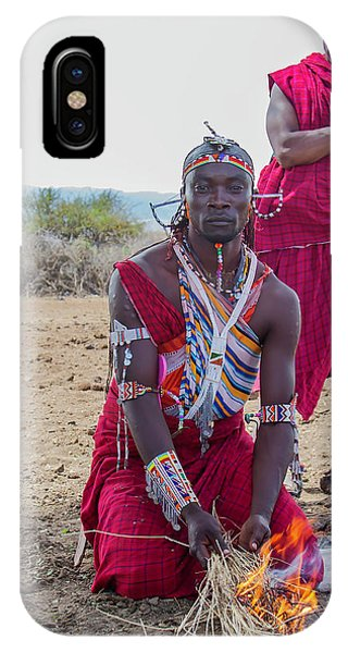 IPhone Case featuring the photograph Maasai Warrior by Thomas Kallmeyer