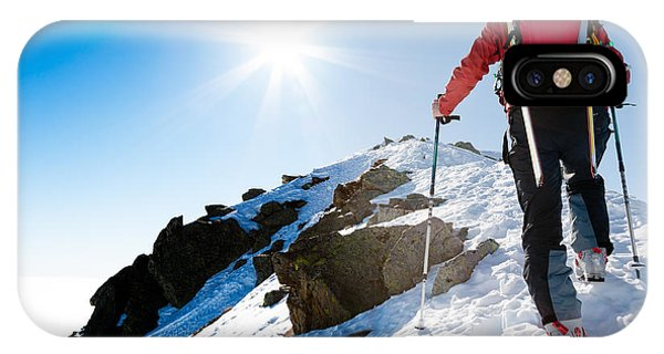 Strength iPhone Case - Mountaineer Walking Up Along A Snowy by Roberto Caucino