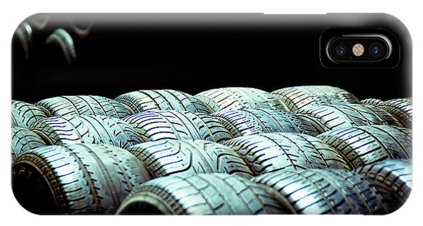 Old Tires And Racing Wheels Stacked In The Sun IPhone Case