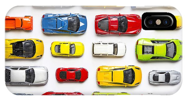 Columns iPhone Case - Overhead View On Colorful Car Toys by Pirke
