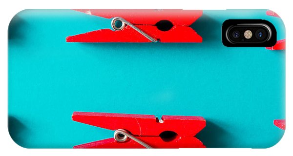 Red Clothespins On Cyan Background Phone Case by Zamurovic Photography