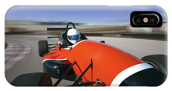 Technology iPhone Case - Red Racing Car Driving At High Speed In by Guillermo Pis Gonzalez
