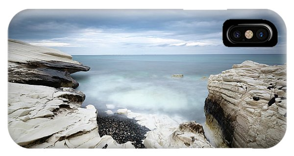 IPhone Case featuring the photograph Rocky Coast With White Limestones And Cloudy Sky by Michalakis Ppalis