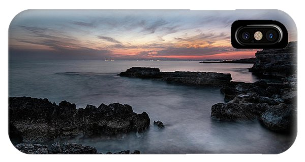 IPhone Case featuring the photograph Rocky Seascape With Dramatic Beautiful Sunset by Michalakis Ppalis