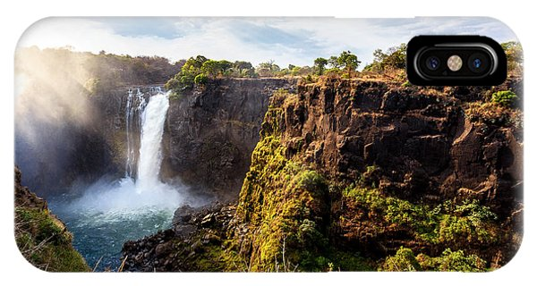 Strength iPhone Case - The Victoria Falls Is The Largest by Artush