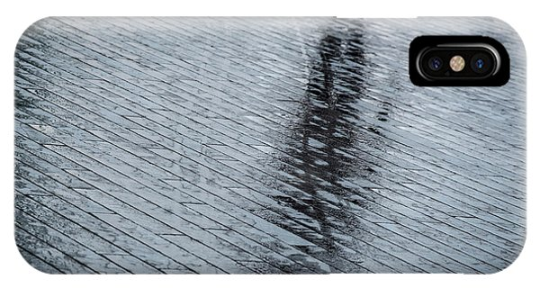 IPhone Case featuring the photograph Walking Shadow Of An Unrecognised Person Walking On Wet Streets  by Michalakis Ppalis