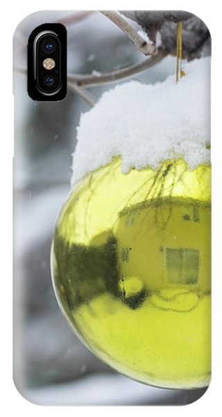 IPhone Case featuring the photograph Yellow Christmas Ball Outside, Covered By Snow And House Reflect by Cristina Stefan