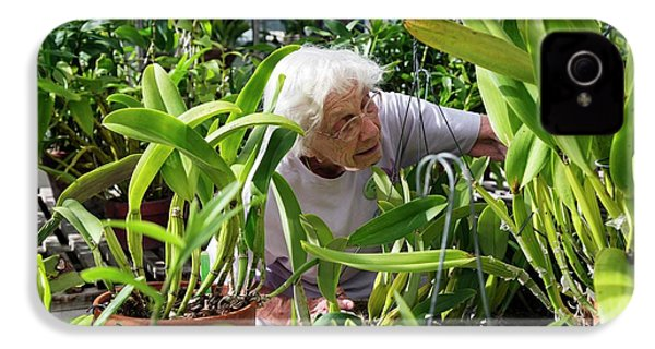 Elderly Woman Examining Plants IPhone 4 Case by Jim West