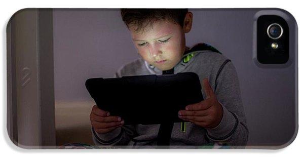 Boy Using A Digital Tablet In The Dark IPhone 5 Case
